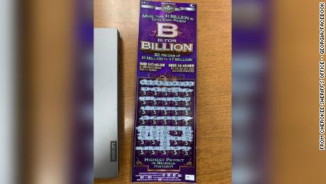 The man's scratch-off ticket is waiting for him at the county jail, a sheriff's spokesman says.