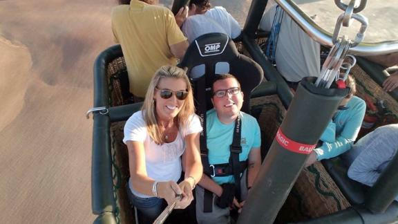 Cory Lee and his mother,  Sandy Gilbreath, on a hot air balloon over the Negev Desert, Israel