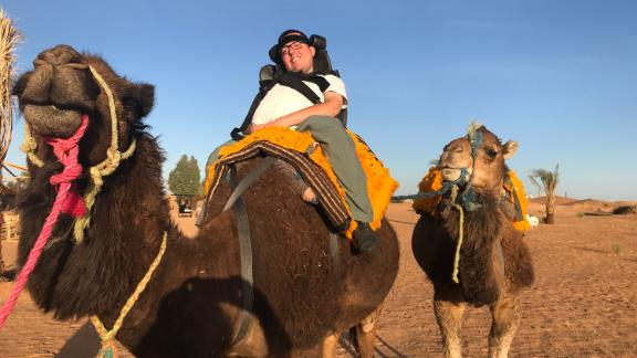Cory Lee riding a camel in Morocco