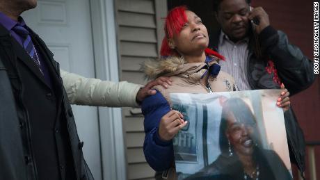 LaTonya Jones is holding a photo of her mother Bettie Jones.