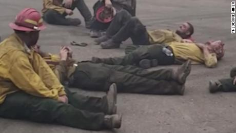Exhausted firefighters sing together after a 14-hour shift against Oregon forest fires