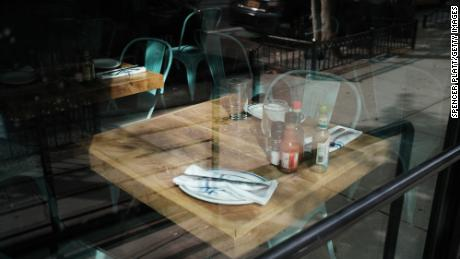 An empty table in a permanently closed restaurant in Manhattan on August 31, 2020 in New York City.