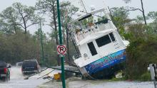 A boat is towed near a road after Hurricane Sally in Orange Beach, Alabama.