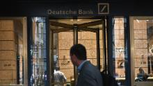 A man is seen outside the US headquarters of Deutsche Bank on July 8, 2019 in New York City. - From Asia to the United States, disconsolate staff at Deutsche Bank dealt Monday with news of massive layoffs with some already heading to the exits to drown their sorrows.The German giant's share price fell to a low of 6.66 euros ($7.47) before closing down 5.4 percent at 6.79 euros, following Sunday's announcement of 18,000 job losses by 2022 as the company transitions out of high-risk investment banking. (Photo by Angela Weiss / AFP)        (Photo credit should read ANGELA WEISS/AFP via Getty Images)