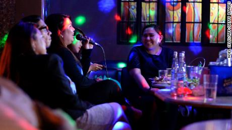 Customers sing karaoke at a nightclub in Davao City, on the southern Philippine island of Mindanao on May 10, 2016.