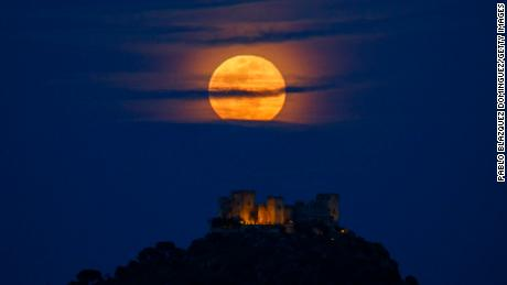 A full (blue) moon rises over Almodovar del Rio Castle on March 31, 2018, in Spain.