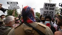Anti-racist and anti-facist protesters led by F.L.O.W.E.R, an organization based in Atlanta to combat racism, face off against far-right militias and White-pride organizations near Stone Mountain Park in Georgia on August 15, 2020.