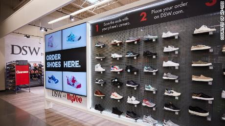 DSW is rolling out mini shoe shops inside of Hy-Vee grocery stores.