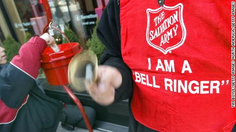 A Salvation Army bell ringer in action outside a Chcago store in 2003.