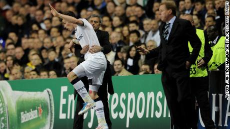 Jose Mourinho holds Gareth Bale during the Champions League quarter final in 2011.