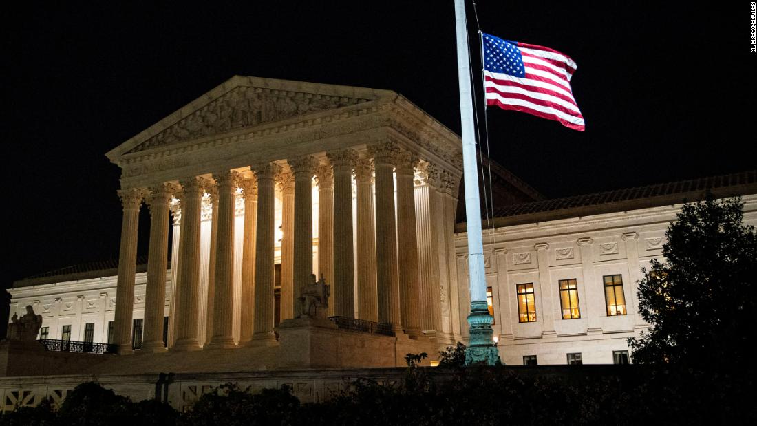 The American flag flies at half staff following the death of Supreme Court Justice Ruth Bader Ginsburg, on Friday, September 18, in Washington.