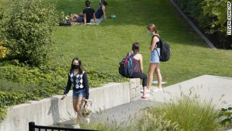 College students wear masks our of concern for the coronavirus on the Boston College campus.