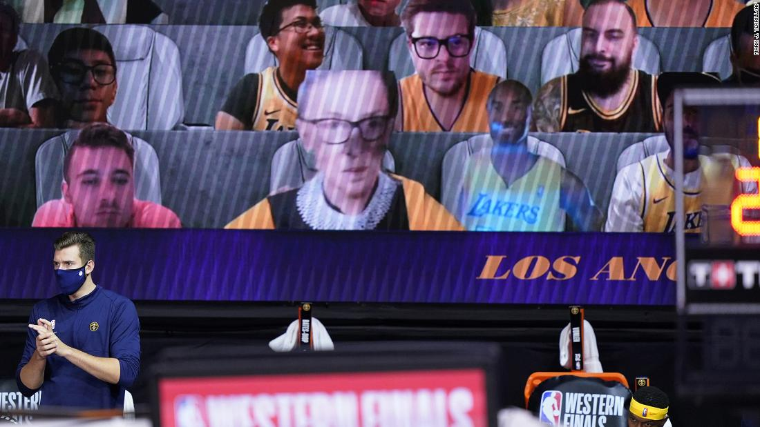 A video board showing virtual fans includes a cutout of Supreme Court Justice Ruth Bader Ginsburg, center left, and the late Kobe Bryant, center right, during the first half of an NBA conference final playoff game between the Los Angeles Lakers and Denver Nuggets on Friday, September 18, in Lake Buena Vista, Florida.
