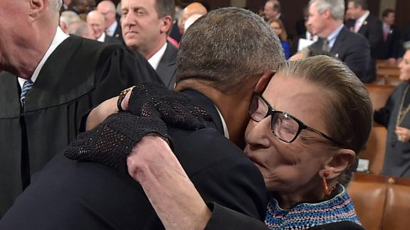 President Barack Obama hugs Ginsburg as he arrives to deliver the State of the Union address in January 2015. Ginsburg didn't shy away from fashion. She often accessorized her black robe with intricate lace collars and an array of different gloves.