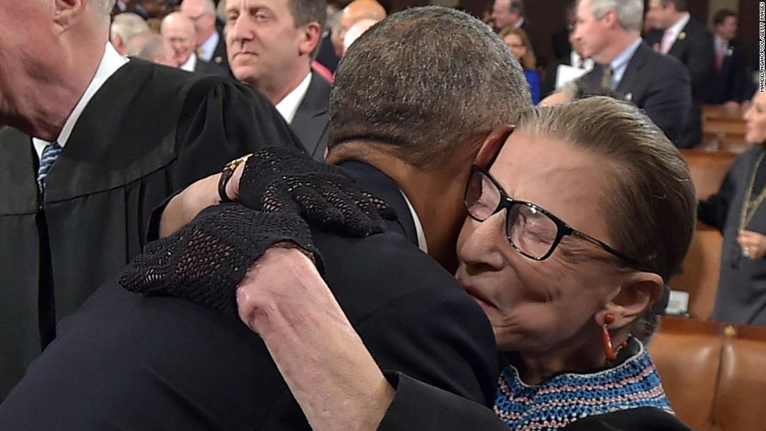 "President Barack Obama hugs Supreme Court Justice Ruth Bader Ginsburg as he arrives to deliver the State of the Union address on January 20, 2015, at the US Capitol in Washington. Ginsburg didn't shy away from fashion. <a href=""https://www.cnn.com/2018/03/21/politics/ruth-bader-ginsburg-scrunchies/index.html"" target=""_blank"">She often accessorized</a> her black robe with her intricate lace collars and an array of different gloves."