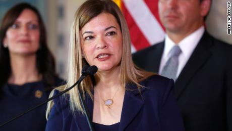 Barbara Lagoa, center, Governor Ron DeSantis' pick for the Florida Supreme Court, speaks after being introduced, as DeSantis and Lt. Gov Jeanette Nunez, left, look on Jan. 9, 2019, in Miami. (AP Photo/Wilfredo Lee)