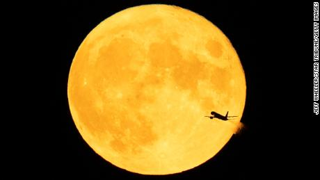 A full moon, which in August is known as a sturgeon moon, is pictured from Minneapolis.