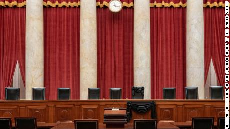 Justice Ruth Bader Ginsburg's Bench chair and the Bench directly in front of it have been draped with black wool crepe in memoriam.