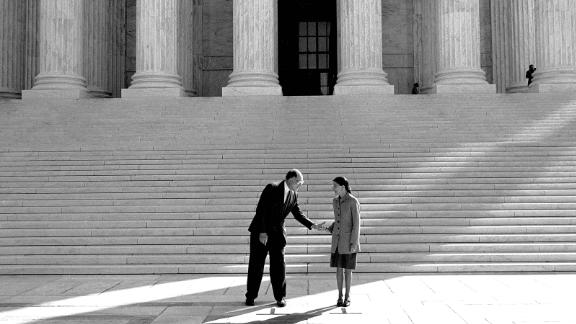 From the steps of the Supreme Court, Rehnquist introduces Ginsburg to the press in October 1993.