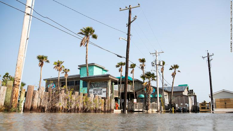 Flood waters fill a parking lot in Port Aransas, Texas on Sunday ahead of Tropical Storm Beta.