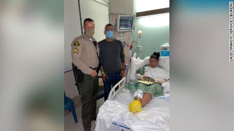 An unidentified sergeant and the injured deputy's husband were by her bedside for the call.