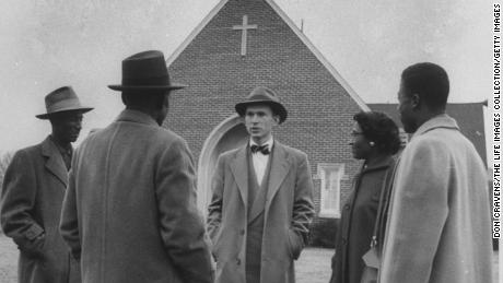 Rev. Robert S. Graetz Jr., pastor of a Black congregation in Montgomery, Alabama, seen talking with friends.