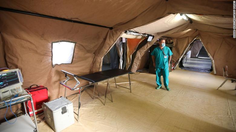 An Italian medic walks around the coronavirus ward of a field hospital on the Lebanese University campus in Hadath on September 8.