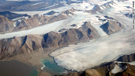 In this view from a passenger plane. melting glaciers are seen during a summer heat wave on Svalbard archipelago on July 28, 2020 near Longyearbyen, Norway.
