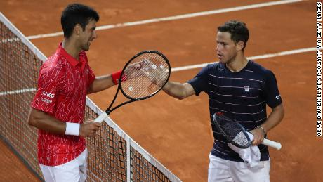 Djokovic (left) meets at the net with Schwartzman following the Italian Open final.