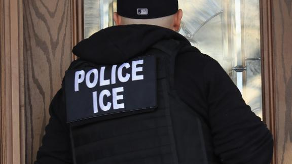 In this April 11, 2018, file photo, Immigration and Customs Enforcement officers arrive at a home in search of an undocumented immigrant in Brooklyn, New York.
