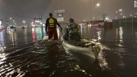 A man is pulled to safety in a kayak after being rescued from his vehicle that stalled in floodwaters caused by Tropical Storm Beta in Houston on Monday.