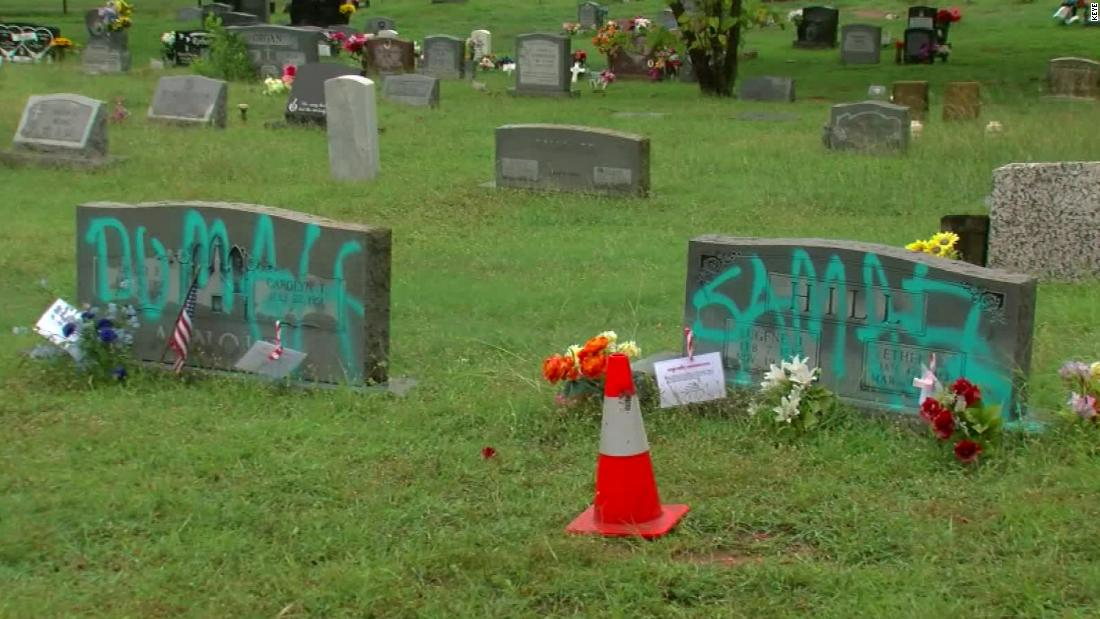 Somebody spray-painted graffiti on headstones in a historically Black cemetery