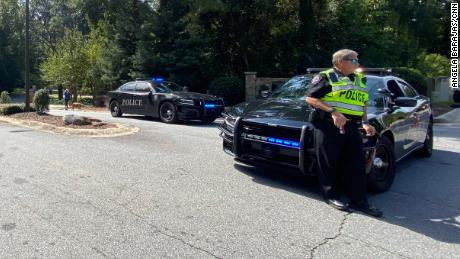 Officers respond to a suburban Atlanta neighborhood after a report of shots fired.