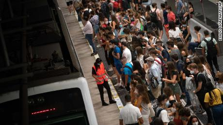 Students wait for the train to go to the university, during a precise moment of rush hour in Barcelona, Spain, Thursday, Sept. 17, 2020. With more than 11,000 new daily coronavirus cases, the attention in Spain is focusing on its capital, where officials are mulling localized lockdowns and other measures to bring down the curve of contagion. (AP Photo/Emilio Morenatti)