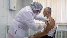 A Russian medical worker adminsters a shot of Russia's experimental Sputnik V coronavirus vaccine in Moscow, on Sept. 15, 2020.