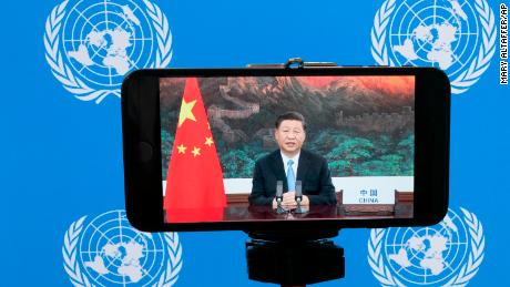 "Chinese President Xi Jinping is seen on a phone screen remotely addressing the 75th session of the United Nations General Assembly, Tuesday, Sept. 22, 2020, at U.N. headquarters. This year's annual gathering of world leaders at U.N. headquarters will be almost entirely ""virtual."" Leaders have been asked to pre-record their speeches, which will be shown in the General Assembly chamber, where each of the 193 U.N. member nations are allowed to have one diplomat present. (AP Photo/Mary Altaffer)"