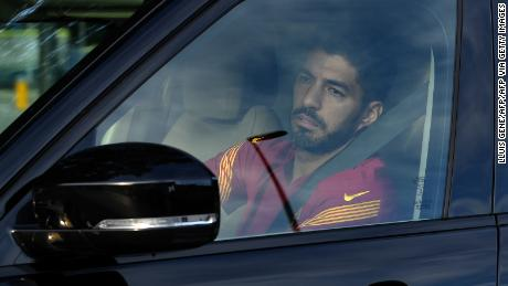 Luis Suarez arrives at a Barcelona training session earlier this month.