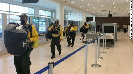 Mexican firefighters arrive in California on Wednesday.