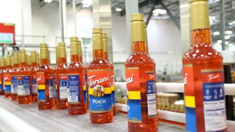 Bottles of Torani Peach syrup move down the production line at the company's new manufacturing facility in San Leandro, California.