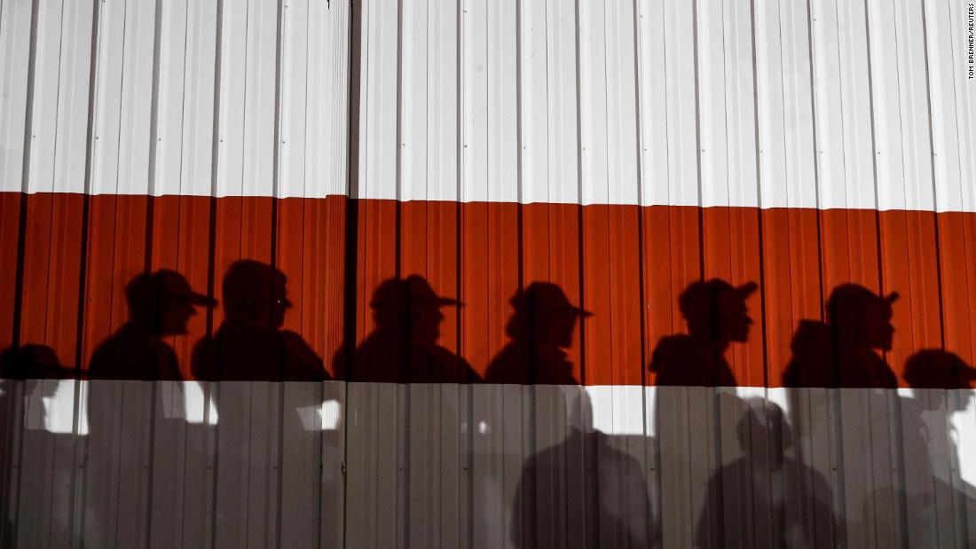 Shadows are cast on a wall during Trump's campaign rally at the Toledo Express Airport in Swanton, Ohio.