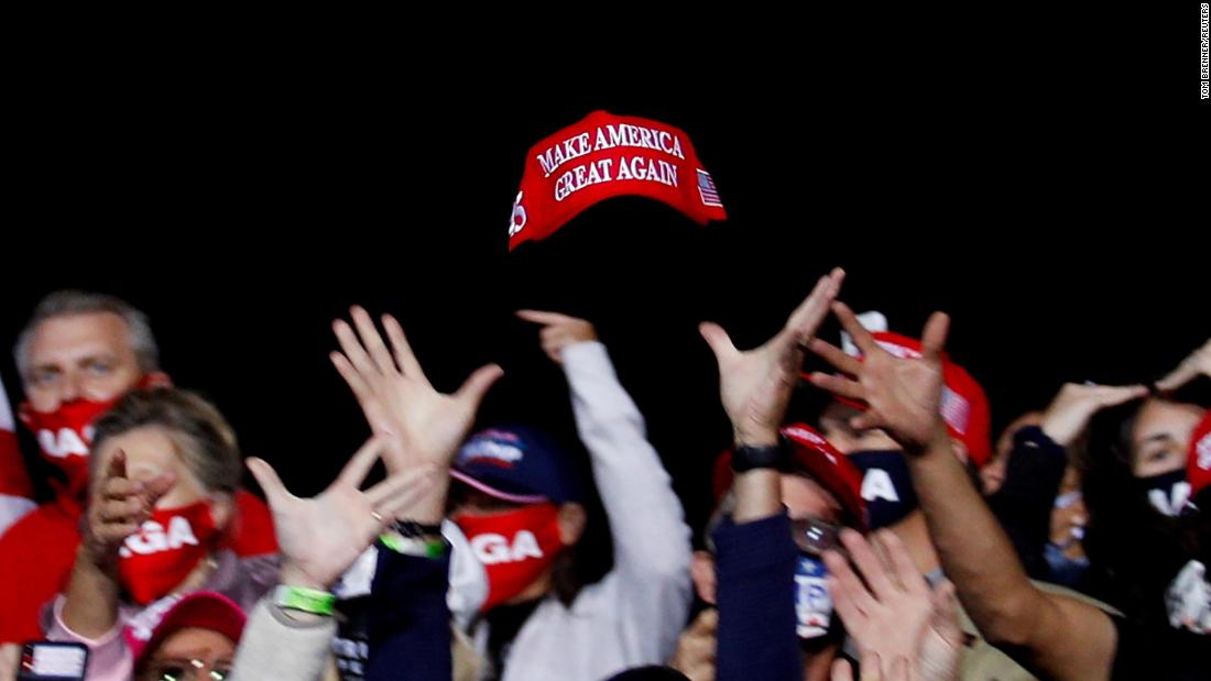Trump supporters try to catch a hat during a campaign event in Fayetteville, North Carolina, on September 19.
