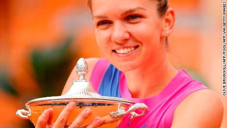 Halep poses with her trophy after winning Italian Open.