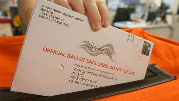 An employee at the Utah County Election office handles mail in ballots in the midterm elections on November 6, 2018 in Provo, Utah. (Photo by George Frey/Getty Images)
