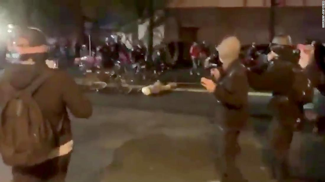 Seattle police officer captured on video riding his bicycle over a protester's head placed on leave – CNN