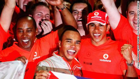 SAO PAULO, BRAZIL - NOVEMBER 02:  New Formula One World Champion Lewis Hamilton of Great Britain and McLaren Mercedes (R) celebrates with his father Anthony Hamilton (L) and his half-brother Nick Hamilton (C) following the Brazilian Formula One Grand Prix at the Interlagos Circuit on November 2, 2008 in Sao Paulo, Brazil.  (Photo by Paul Gilham/Getty Images)