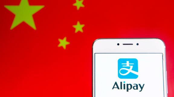 HONG KONG - 2019/04/06: In this photo illustration a Chinese online payment platform owned by Alibaba Group, Alipay, logo is seen on an Android mobile device with People