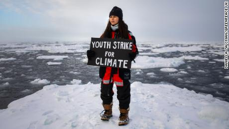 Environmental activist and campaigner Mya-Rose Craig, 18, protests on an ice floe in the Arctic.