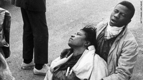 A civil rights marcher, suffering from exposure to tear gas, holds an unconscious Amelia Boynton after the police attacked marchers in Selma, Alabama, on March 7, 1965.