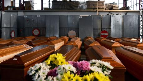 A general view shows some of 35 coffins of deceased people stored in a warehouse in Ponte San Pietro, near Bergamo, Lombardy, on March 26, 2020, before being taken to another region to be cremated during the country's lockdown.