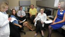 Dr. Carla Sevin consults with her team in the ICU Survivors Clinic at Vanderbilt University Medical Center.